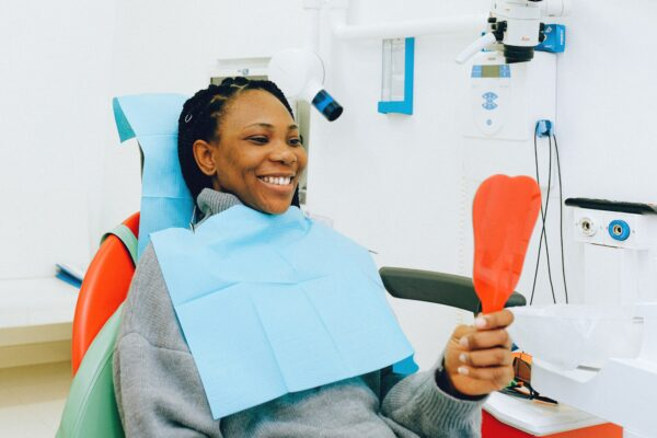 Care for your teeth : Image showing happy woman at the dental clinic