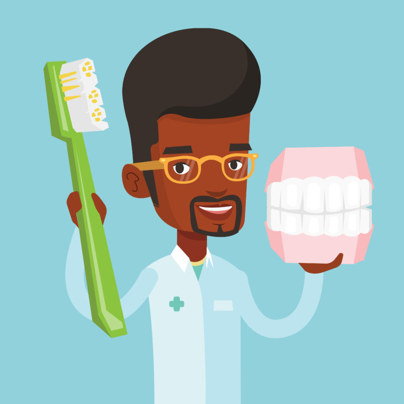 Dental examination and consultation : Image showing African male dentist with a jaw model and a toothbrush