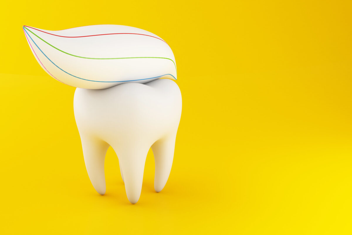 THE GOODNESS OF FLUORIDE : 3D tooth with toothpaste on it.