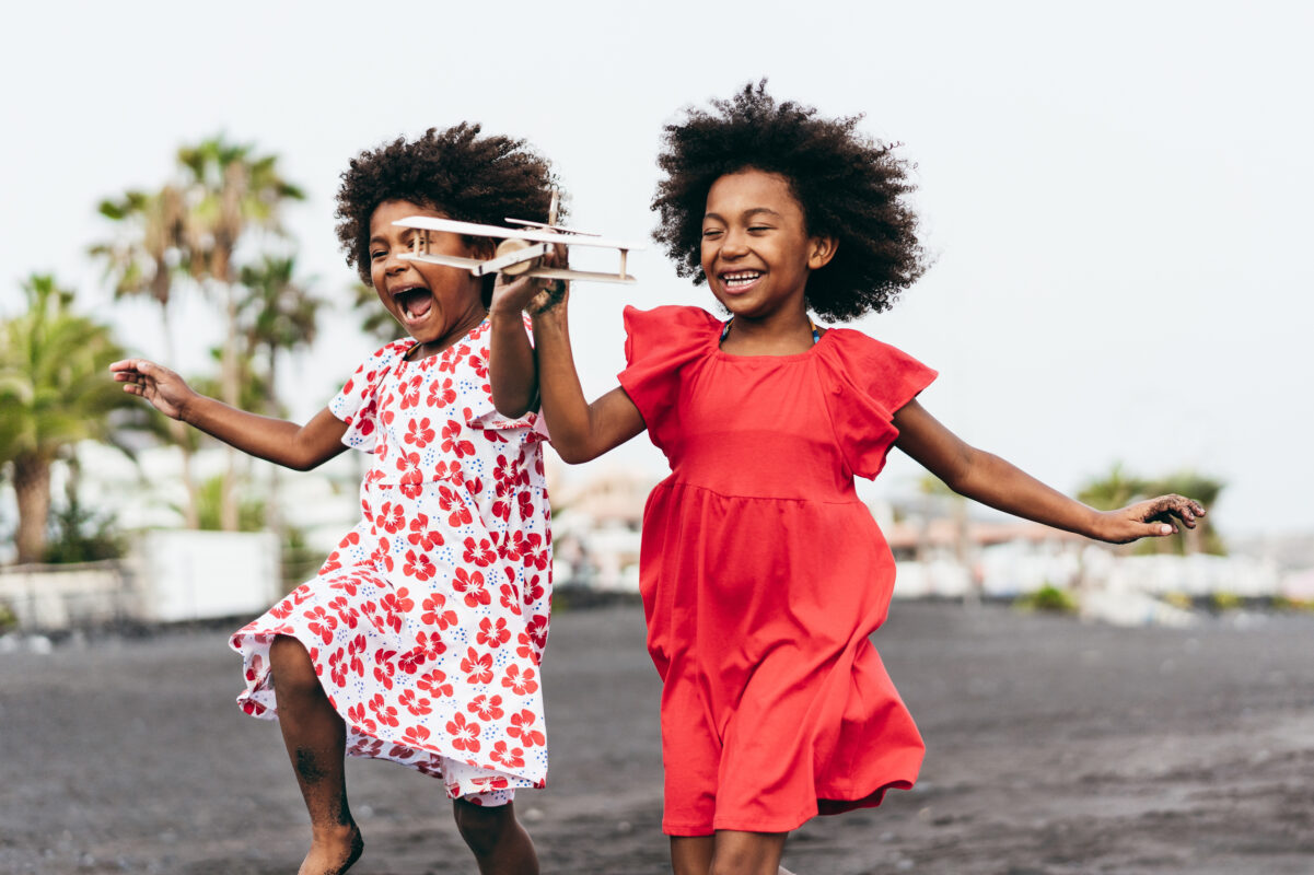 Dental Injuries in children : image showing two African girls playing on the beach
