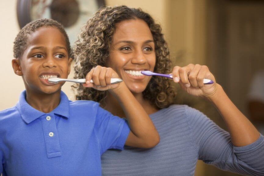 Preventive dental care : Image showing mother and child brushing