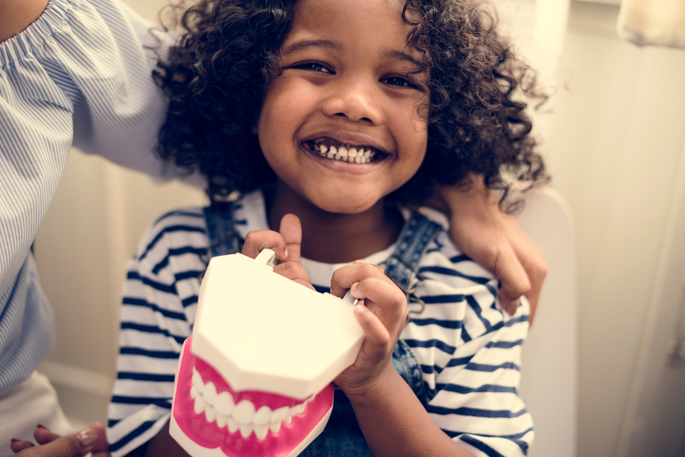 Traumatic dental injuries : Image showing a happy African child at the dental clinic