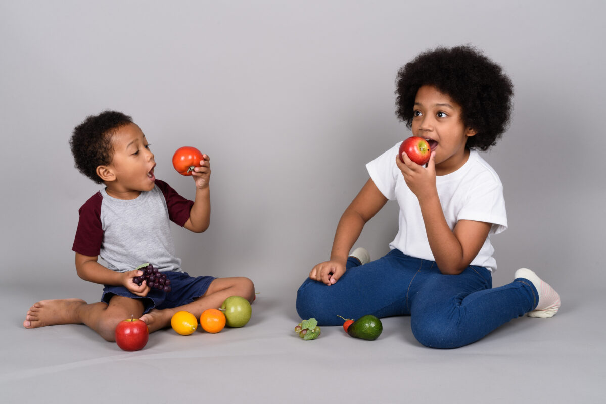 SWEET TOOTH : An illustration showing Young cute African siblings eating fruits